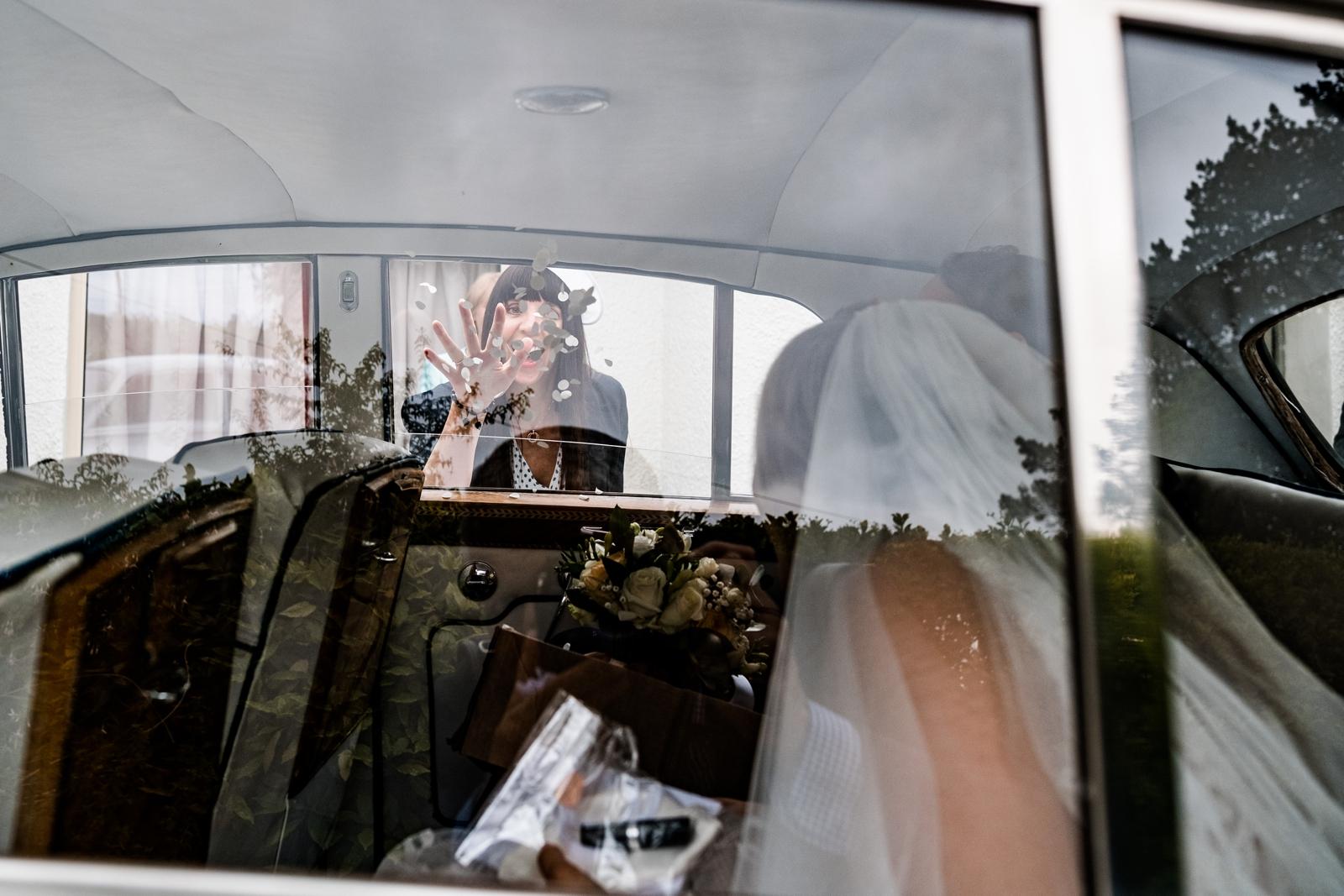 Confetti thrown in wedding car