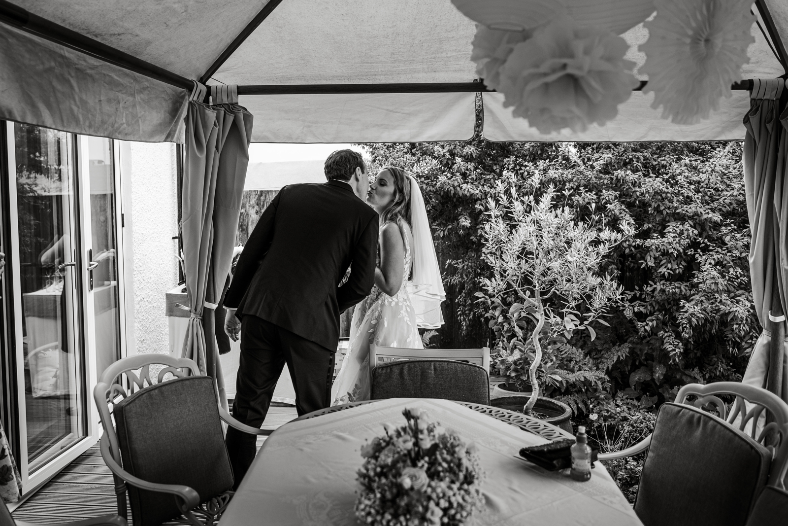 Bride and groom enter home wedding reception
