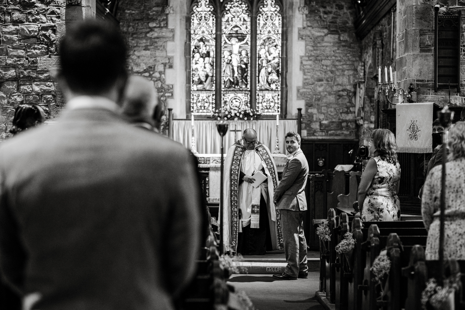 Groom waiting at church for bride in Monmouthshire, South Wales